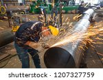 male worker wearing protective... | Shutterstock . vector #1207327759