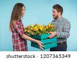 happy man and woman florists... | Shutterstock . vector #1207365349