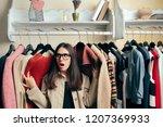 funny girl between many... | Shutterstock . vector #1207369933