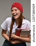 exchange girl student laughing | Shutterstock . vector #1207380409