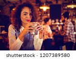 portrait of young woman having... | Shutterstock . vector #1207389580