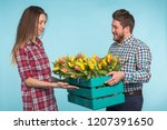 happy man and woman florists... | Shutterstock . vector #1207391650