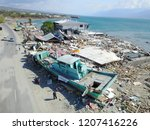 Small photo of The impact of the tsunami that occurred along the Palu bay and the Wani ship port that occurred on 28 September 2018