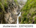 savica waterfal near bohinj... | Shutterstock . vector #1207423393