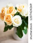 yellow and white roses in a... | Shutterstock . vector #1207424269