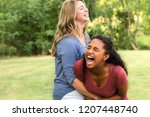 mother and daughter laughing. | Shutterstock . vector #1207448740