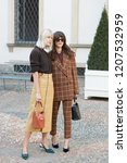 Small photo of MILAN, ITALY - SEPTEMBER 21, 2018: Linda Tol and Eleonora Carisi before Tods fashion show, Milan Fashion Week street style