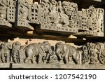 Friezes and sculptures on the outer walls of Hoysaleswara Temple at Halebidu , Karnataka, India. A 12th-century Hindu temple. It is the largest monument in Halebidu, the former capital of the Hoysala.
