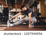 handsome man doing warm up in... | Shutterstock . vector #1207544056