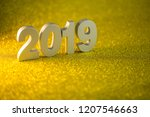 golden confetti with text 2019... | Shutterstock . vector #1207546663