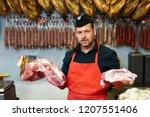 portrait of a handsome butcher... | Shutterstock . vector #1207551406