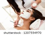 aesthetics applying a mask to... | Shutterstock . vector #1207554970