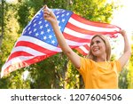 woman with american flag in...   Shutterstock . vector #1207604506