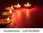 happy diwali   clay diya lamps... | Shutterstock . vector #1207623856