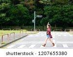 girl walking on a crosswalk | Shutterstock . vector #1207655380