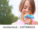 pretty little girl eating... | Shutterstock . vector #1207680616