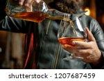 whisky  brandy or cognac in... | Shutterstock . vector #1207687459
