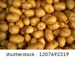 Small photo of Clean shiny potatoes jumbled on top of each other in a pile