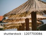 reed sunshade pattern beside... | Shutterstock . vector #1207703086