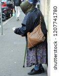 mendicant homeless   poverty... | Shutterstock . vector #1207741780