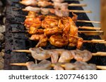 grilled fried seafood on... | Shutterstock . vector #1207746130