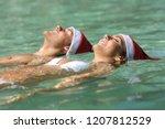 Happy Couple Wearing Santa Hat...