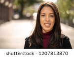 young hispanic woman in city... | Shutterstock . vector #1207813870