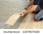 work on laying flooring. worker ... | Shutterstock . vector #1207837600
