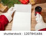 Santa Claus Holding Letter On...