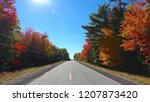 lens flare  empty asphalt road... | Shutterstock . vector #1207873420