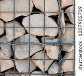 gabion cage filled with rocks | Shutterstock . vector #1207902739