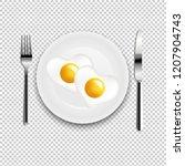 plate with fried egg heart fork ... | Shutterstock . vector #1207904743