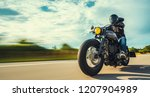 motorbike on the forest road... | Shutterstock . vector #1207904989