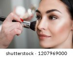 close up of makeup artist... | Shutterstock . vector #1207969000