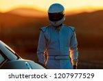 a helmet wearing race car... | Shutterstock . vector #1207977529