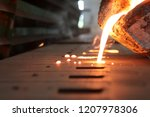 Small photo of Light from high temperature Iron molten metal pouring in green sand mold ;Foundry process to manufacture cast product for automotive and electrical; industrial engineering metallurgy background
