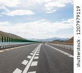 wild field highway    Shutterstock . vector #1207979119