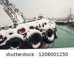 snow covered tugboat at snowy... | Shutterstock . vector #1208001250