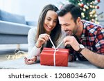 happy couple opening a... | Shutterstock . vector #1208034670