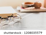 close up eyes glasses on wooden ... | Shutterstock . vector #1208035579
