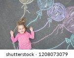 little child lying near chalk...   Shutterstock . vector #1208073079