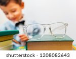 glasses on a stack of books ... | Shutterstock . vector #1208082643