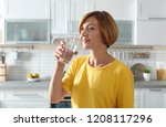 woman drinking clean water from ... | Shutterstock . vector #1208117296