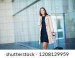 young cheerful woman with a... | Shutterstock . vector #1208129959