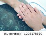 doctor comforting patient with... | Shutterstock . vector #1208178910