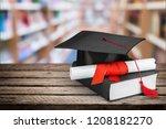 graduation mortarboard on  book ...   Shutterstock . vector #1208182270