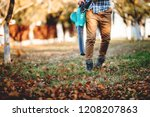 details of leaves blowing  man... | Shutterstock . vector #1208207863