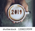 female hands holding white cup... | Shutterstock . vector #1208219599