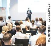 speaker giving a talk in...   Shutterstock . vector #1208229823
