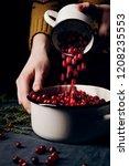 female hands pouring ripe... | Shutterstock . vector #1208235553